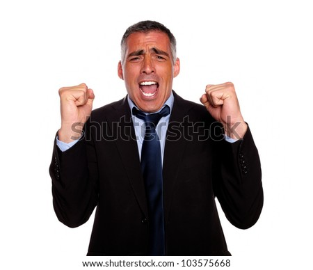 Portrait of a excited and happy broker screaming and celebrating a victory on isolated background - stock photo