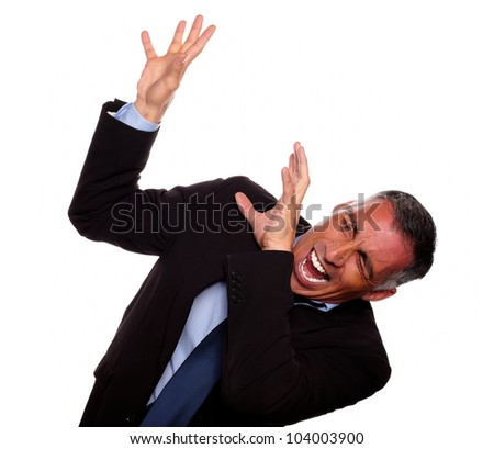 Portrait of a excited executive screaming with hands up while falling down on black suit against white background - stock photo