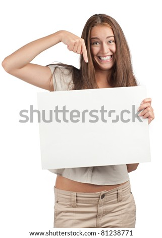 Portrait of a excited young woman holding a blank signboard and pointing, isolated on white background - stock photo