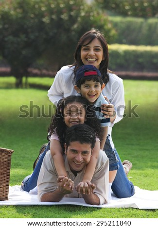 Portrait of a family at a picnic - stock photo