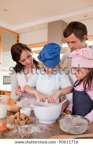Portrait of a family baking in a kitchen - stock photo