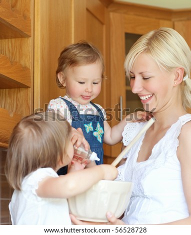 Portrait of a family cooking in the kitchen - stock photo
