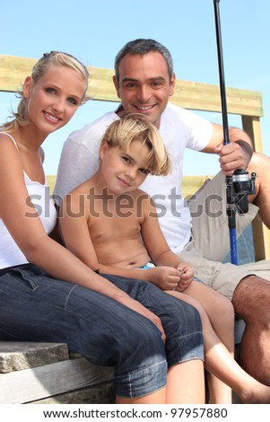 portrait of a family fishing - stock photo