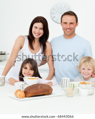 Portrait of a family having breakfast together in the kitchen at home