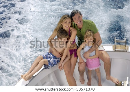 Portrait of a family in a boat - stock photo