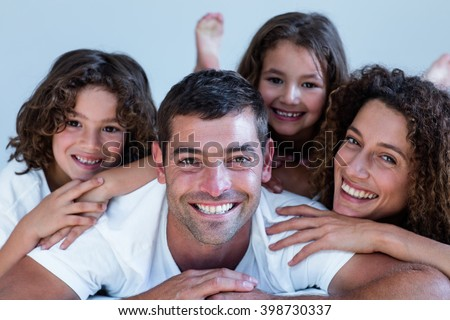 Portrait of a family lying on bed at home
