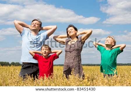 portrait of a family of a four at field