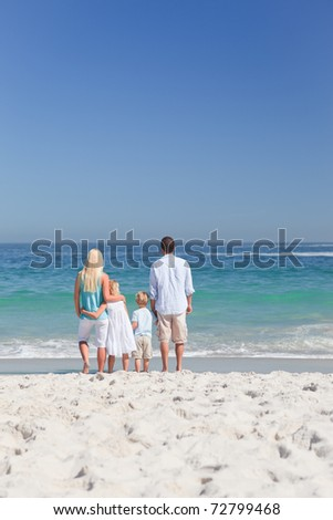 Portrait of a family on the beach - stock photo