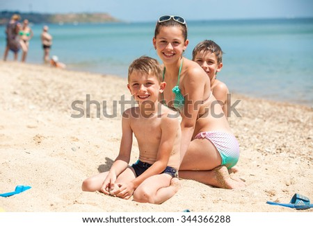 Portrait of a family on the beach in summer