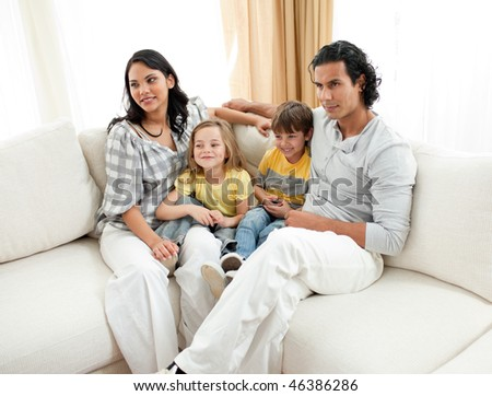 Portrait of a family sitting on sofa at home
