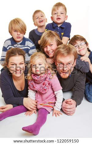 Portrait of a family with five boys and one girl - stock photo