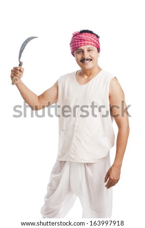 Portrait of a farmer holding a sickle and smiling - stock photo