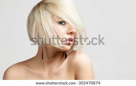 Portrait of a fashion blonde with short hair and bare shoulders - stock photo