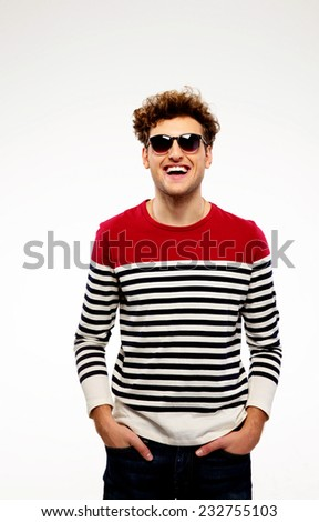 Portrait of a fashion laughing man over gray background
