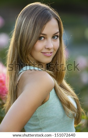 Portrait of a fashion model in a blue shirt - stock photo