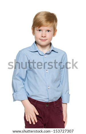 Portrait of a fashion red-haired boy on the white background