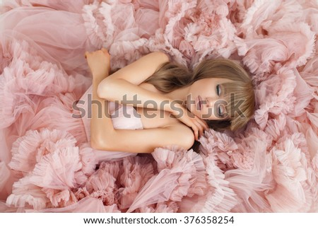Portrait of a fashion woman in gorgeous long pink dress