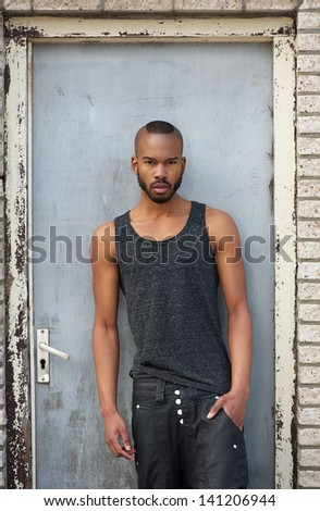Portrait of a fashionable african american male model standing outdoors - stock photo