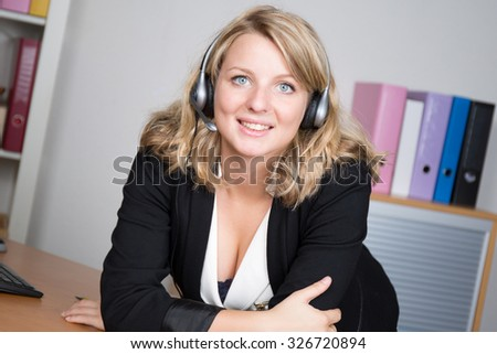 Portrait of a fashionable cute office girl wearing headset.