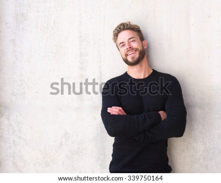 Portrait of a fashionable man with beard laughing  - stock photo