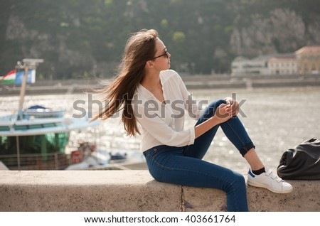 Portrait of a fashionable stylish brunette beauty outdoors.