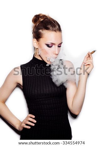 Portrait of a fashionable woman with a cigarette holder. Perfect skin. Retro style. Studio shot on white background not isolated - stock photo