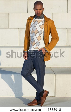 Portrait of a fashionable young man standing outdoors - stock photo