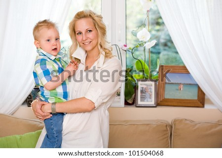 Portrait of a fashionable young mother with her cute son. - stock photo