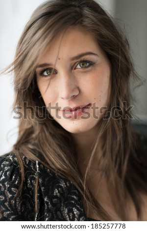 portrait of a fashionable young woman - stock photo