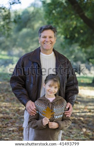 Portrait of a Father and Daughter Together in a Park