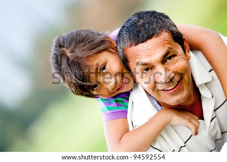 Portrait of a father and his daughter having fun outdoors - stock photo