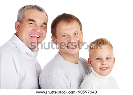 Portrait of a father, grandfather and son standing in line - stock photo