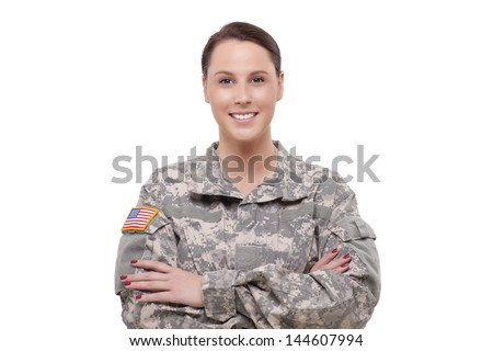 Portrait of a Female army soldier with arms crossed  - stock photo