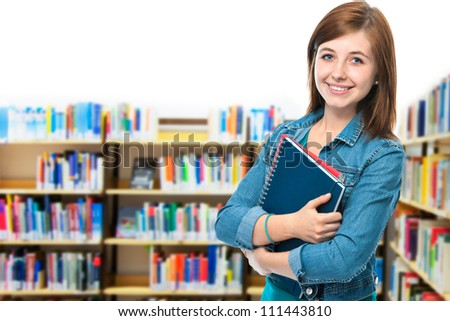 portrait of a female college student at campus library - stock photo