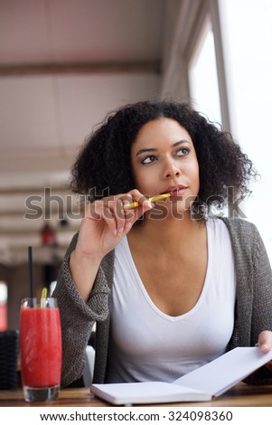 Portrait of a female college student thinking  - stock photo