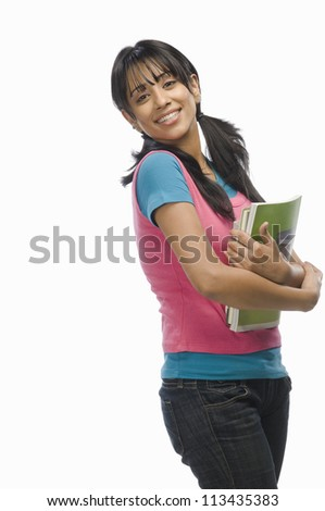 Portrait of a female college student with files