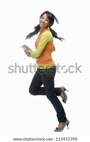 Portrait of a female college student with files - stock photo