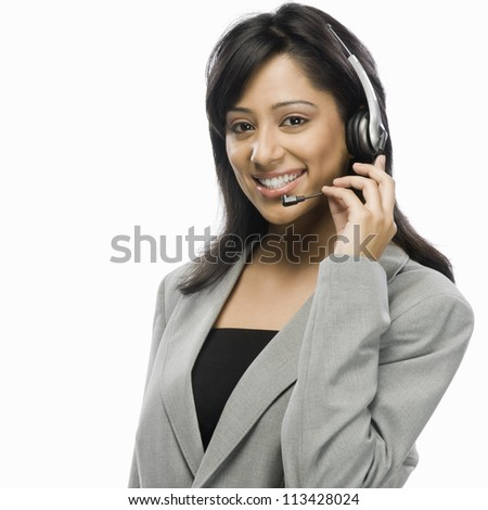 Portrait of a female customer service representative smiling - stock photo