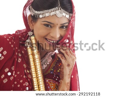 Portrait of a female dandiya dancer with sticks