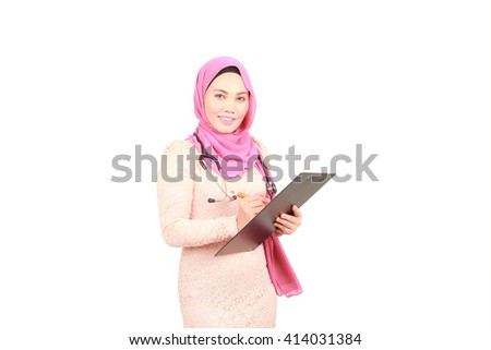 Portrait of a female doctor taking notes against a white background - stock photo