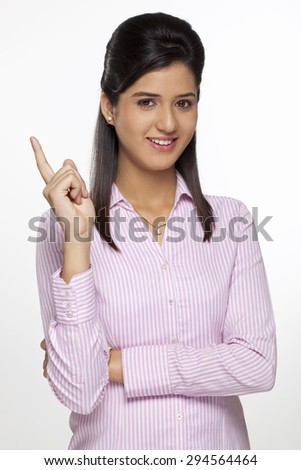 Portrait of a female executive making a hand gesture - stock photo