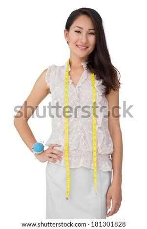 Portrait of a female fashion designer standing over white background - stock photo