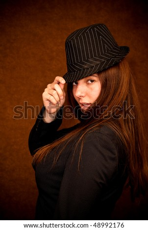 Portrait of a Female in Striped Hat and Coat - stock photo