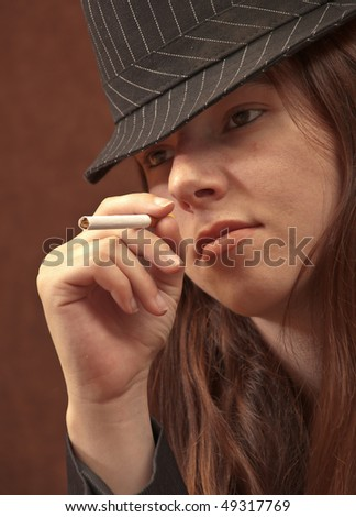 Portrait of a Female Mobster with a Cigarette - stock photo