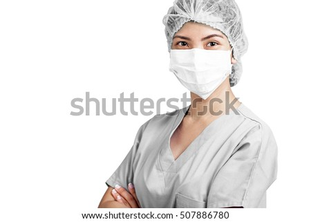 Portrait of a female nurse or doctor in medical scrubs and mask isolated in white background.