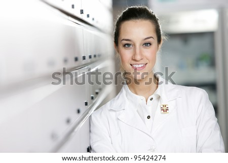 portrait of a female pharmacist at pharmacy - stock photo