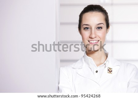 portrait of a female pharmacist at pharmacy, copy space - stock photo