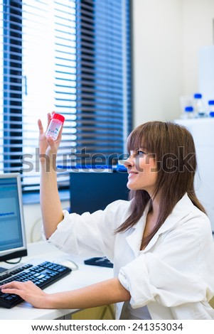 Portrait of a female researcher carrying out research in a chemistry lab (color toned image; shallow DOF)