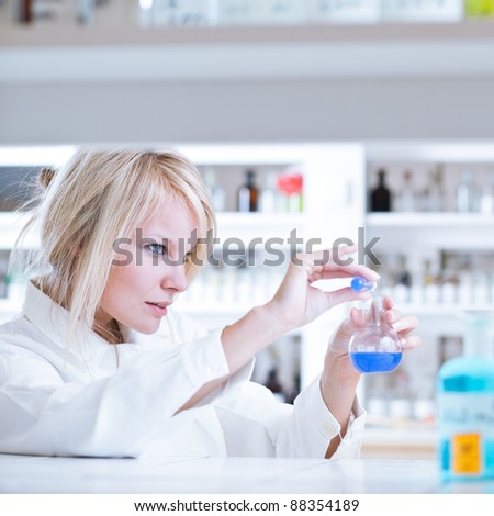 portrait of a female researcher/chemistry student carrying out research in a lab - stock photo