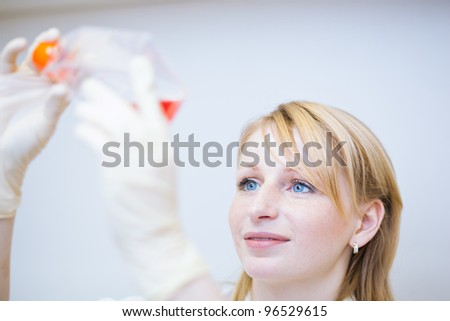 portrait of a female researcher doing research in a lab (color toned image; shallow DOF) - stock photo